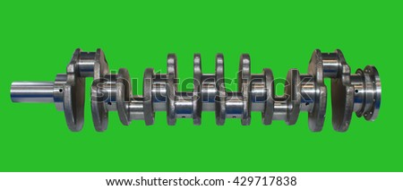 Isolated on green background crankshaft from engine car. Chromakey Green Screen. Auto part and spare part - stock photo