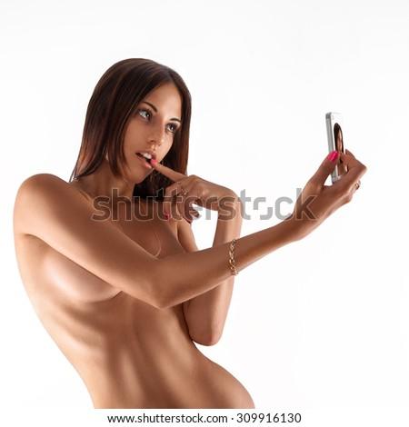 Isolated on white background woman making erotic selfie. studio shot. square. - stock photo