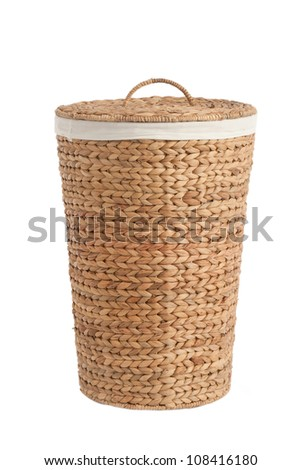 Isolated on white laundry basket made of rattan - stock photo