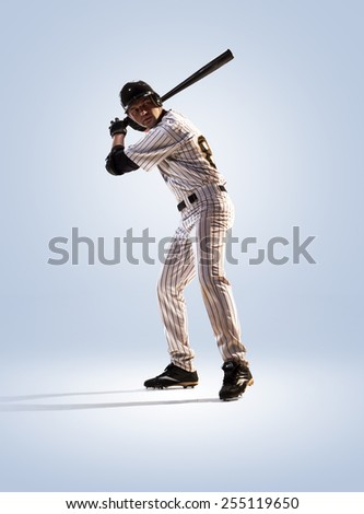 isolated on white professional baseball player in action - stock photo