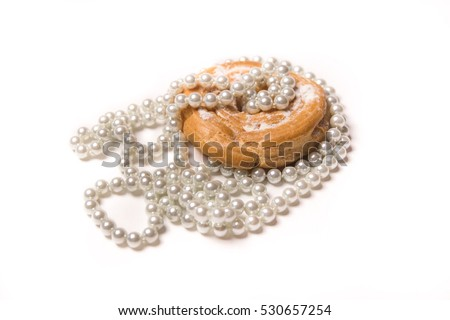 isolated on white sweet nice donut with pearl jewelry necklace