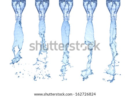 Isolated on white water splashes from a bottles - stock photo