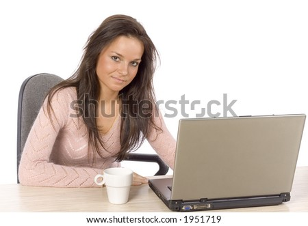 isolated on white young woman at the desk with laptop - stock photo