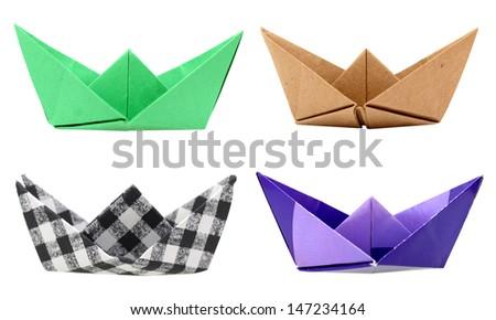 Isolated origami boats on white background - stock photo