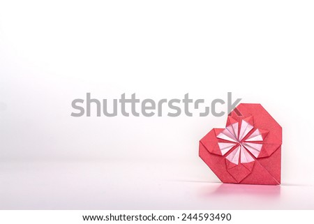 isolated origami red heart