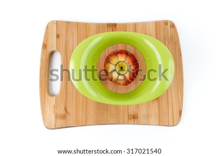 Isolated Overhead View of Apple about to be Sliced on a Bamboo Cutting Board - stock photo