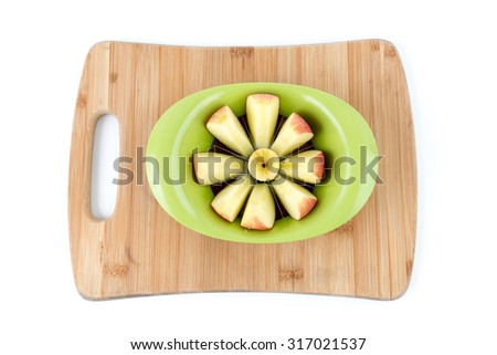 Isolated Overhead View of Apple being Sliced on a Bamboo Cutting Board