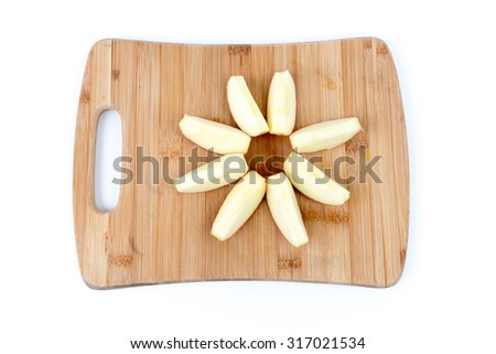 Isolated Overhead View of Apple Slices on a Bamboo Cutting Board - stock photo