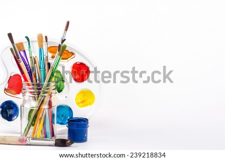isolated paints brushes and paints palette - stock photo