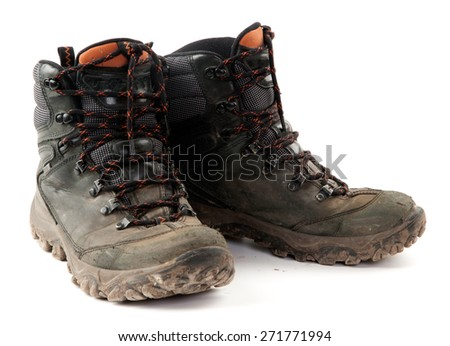Isolated Pair of Dirty Boots on white background. - stock photo