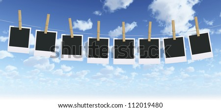 Isolated Photo Frame with clothespin on Sky Background