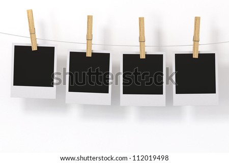 Isolated Photo Frame with clothespin on White Background - stock photo