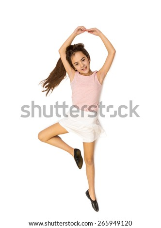 Isolated photo from high point view of cute girl lying on floor and pretending to dance ballet - stock photo