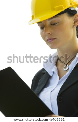 Isolated photo of a female construction worker with a clipboard and hard hat
