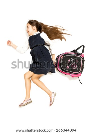 Isolated photo of cute schoolgirl being late and running to school with backpack - stock photo