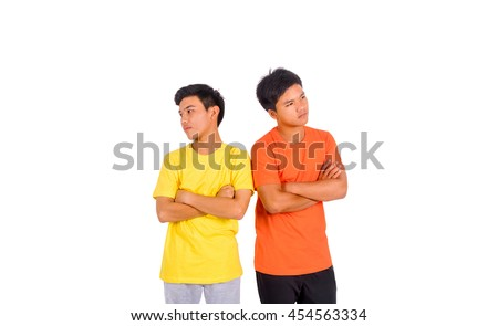 Isolated photo of two offending asian men - stock photo