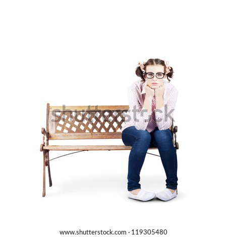 Isolated Photograph Of A Sad Lonely Nerdy Woman Sitting On A Park Bench All Alone On White Background