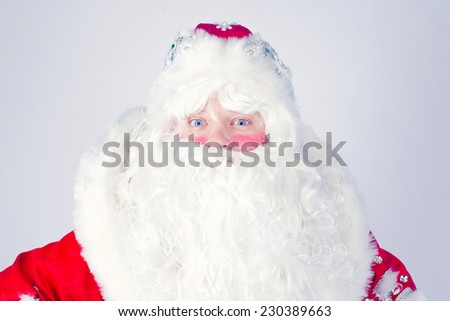 Isolated Picture of Santa Claus with gifts bag with beard in traditional red costume, christmas