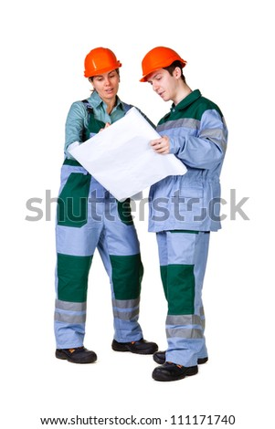Isolated picture of young construction workers with blueprint - stock photo