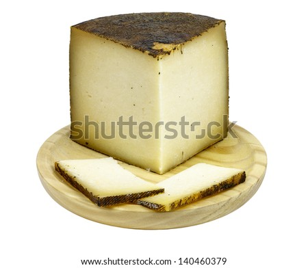 isolated piece of manchego cheese isolated on a white background