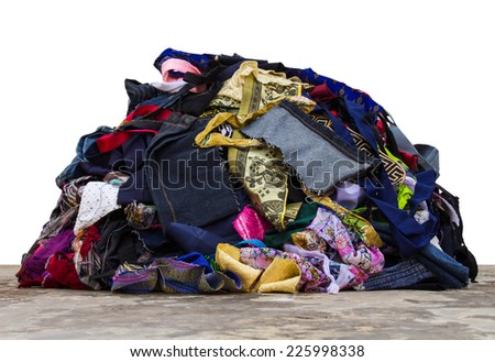 Isolated pile of fabric pieces from a variety of sewing repairs. - stock photo