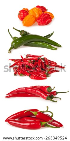 Isolated piles of various kind of chilli peppers isolated on white background - stock photo
