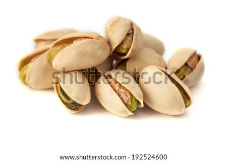 Isolated pistachios - stock photo
