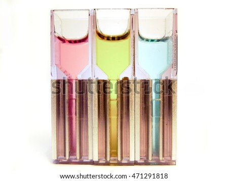 Isolated plastic alloy cuvette filled with colorful chemical liquids. These flasks are used in the laboratory for various samples: genetic DNA modification or spectrophotometry. Ideal for innovation.