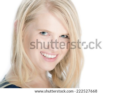Isolated portrait head shot of young, beautiful white business women, smiling with blonde hair on white studio background. She shows a clean, corporate style with fresh, natural skin and makeup.