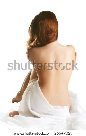 Isolated portrait of a beautiful and sexy young woman, sitting with a bare back.