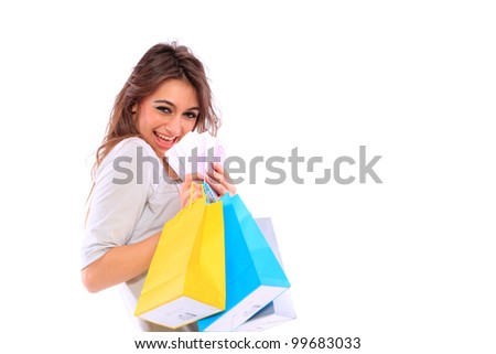 isolated portrait of a beautiful caucasian woman with some shopping bags holding money