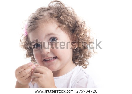 Isolated portrait of a blonde child smiling with copy space