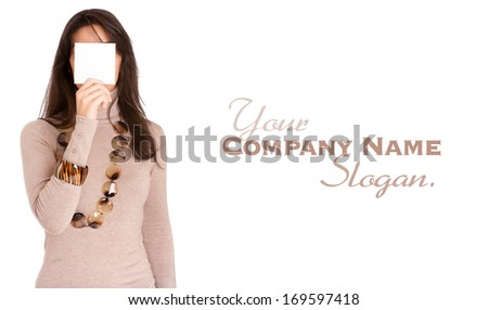 Isolated portrait of a brunette hiding her face with a bk note  - stock photo