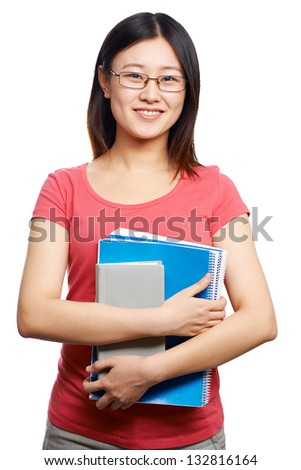 Isolated portrait of a female college student holding copybooks - stock photo