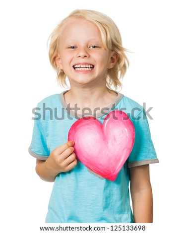Isolated portrait of a very cute young boy laughing and holding a love heart. Isolated on white.