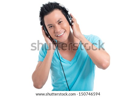 Isolated portrait of a young cool boy with earphones smiling and looking at camera - stock photo