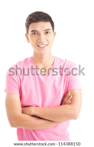 Isolated portrait of a young guy standing with his arms crossed - stock photo