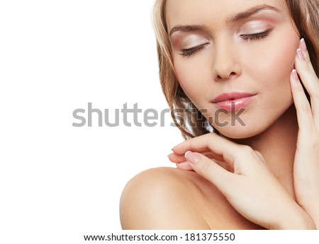Isolated portrait of a young perfect woman touching her face - stock photo