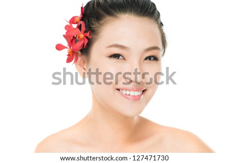 Isolated portrait of an Asian beauty with flowers in her hair