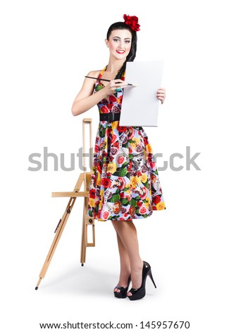 Isolated portrait of an attractive young female artist painting fine art message on blank canvas next to easel  - stock photo