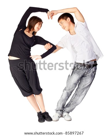 isolated portrait of asian guy and european girl dancing hustle standing togeteher in heart shape - stock photo