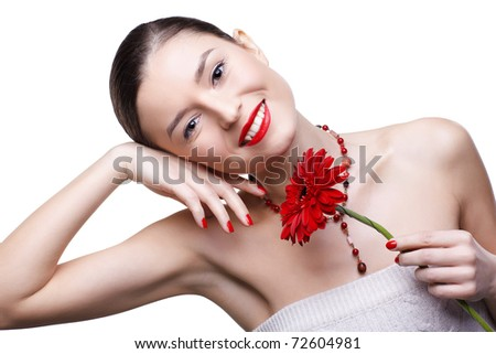 isolated portrait of beautiful happy brunette girl with red gerbera flower - stock photo