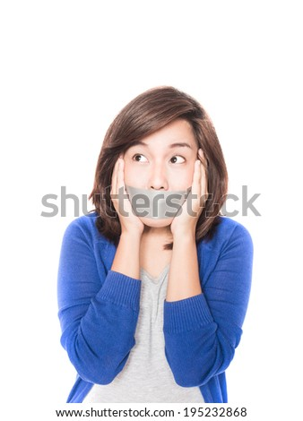 Isolated portrait of beautiful young  woman has duct tape at mouth on white background. - stock photo