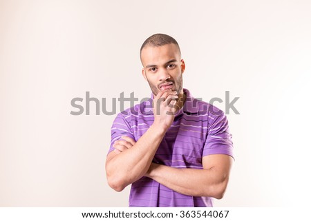 isolated portrait of doubting african man
