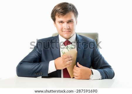 Isolated portrait of venal politician putting money in envelope in pocket of his suit - stock photo