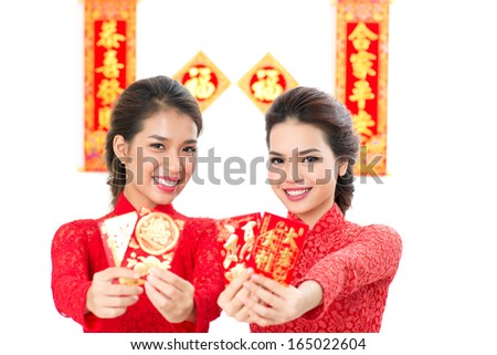 Isolated portrait of young attractive women with wishes cards in hands on white - stock photo