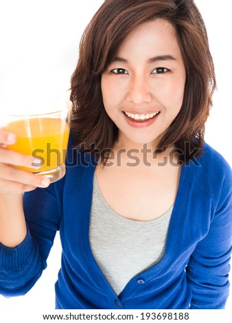 Isolated portrait of young happy woman drinking orange juice smiling on white background. Pretty female model happy smiling. - stock photo