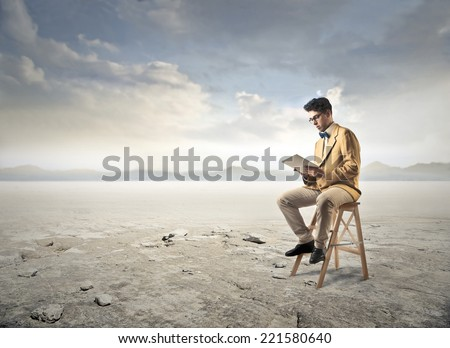 Isolated reading something  - stock photo
