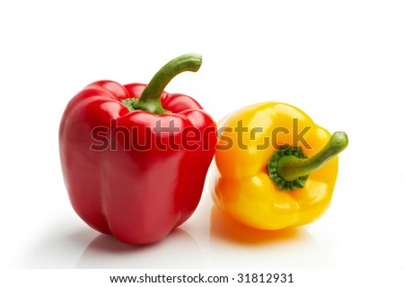 isolated red and yellow peppers on white background - stock photo