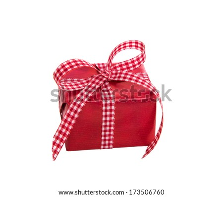 Isolated red gift box with a checked ribbon on a white background - stock photo